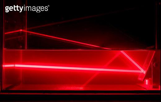Reflection of laser beam in water - gettyimageskorea