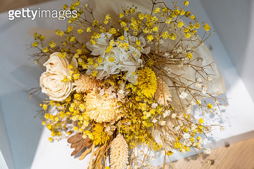 Directly Above Shot Of Dried Bouquet. A bunch of withered field flowers and pink roses on a grey slab - gettyimageskorea