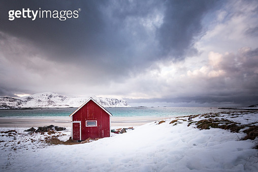 Red house on the snowy beach, Norway - gettyimageskorea