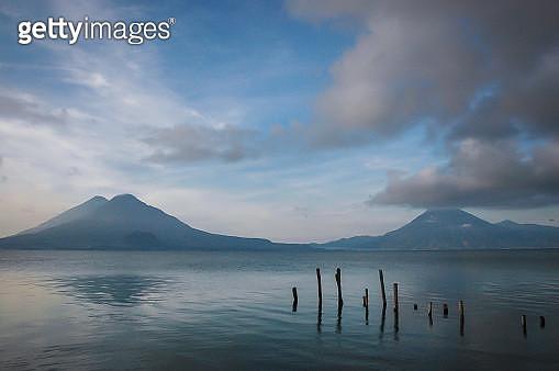 The beautiful Atitlan and San Pedro volcanos lining Lake Atitlan, Guatemala - gettyimageskorea