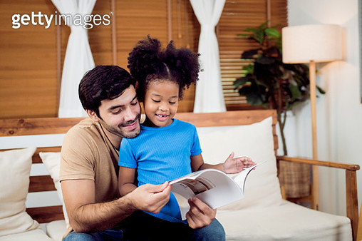 Father and daughter enjoying at home - gettyimageskorea