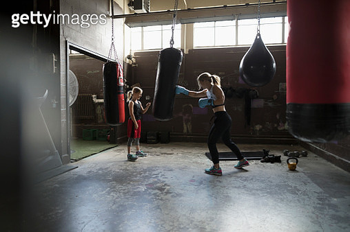 Mother boxer teaching daughter boxing at gym - gettyimageskorea