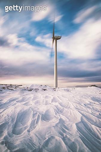 Windmill standing in snow - gettyimageskorea