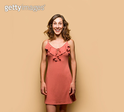 Young woman in pink summer dress - gettyimageskorea