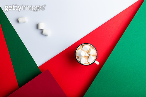 Hot chocolate with marshmallows in rural mug on colorful paper background - gettyimageskorea