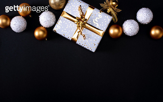Merry Christmas and Happy Holidays greeting card, frame, banner. New Year. Christmas white handmade gift boxes on black marble background top view. - gettyimageskorea