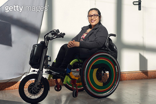 Portrait of young woman on wheelchair - gettyimageskorea
