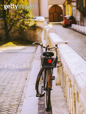 Bicycle parked on the street - gettyimageskorea