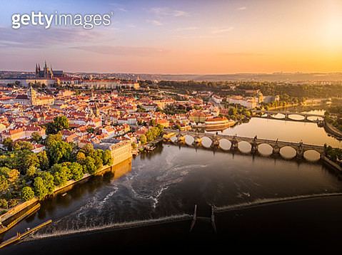 Aerial view of Prague Castle, cathedral and Charles Bridge at sunrise in Prague - gettyimageskorea