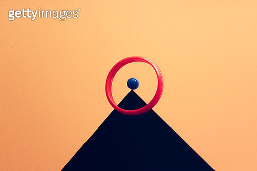 conceptual image of a marble balancing on a peak with a ring surrounding it, symbolizes balance - gettyimageskorea
