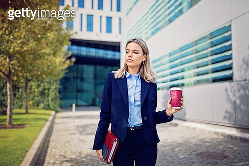 Portrait of young businesswoman walking to the office - gettyimageskorea