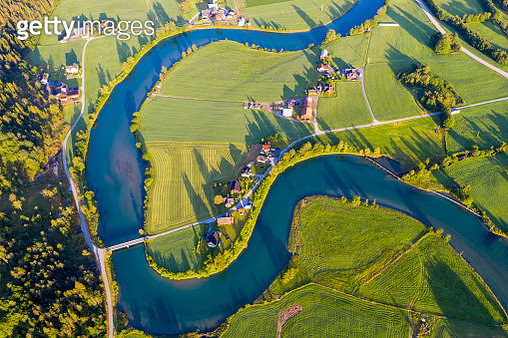 Sunrise over the winding Stryneelva river and cultivated fields from above, Stryn, Nordfjorden, Sogn og Fjordane county, Norway - gettyimageskorea