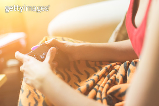 Woman playing videogames - gettyimageskorea