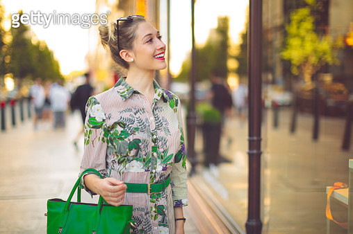 Young woman is window shopping - gettyimageskorea