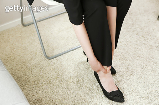 Businesswoman suffering from ankle pain - gettyimageskorea