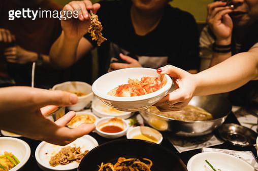 Friends sharing Korean food together - gettyimageskorea