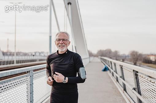Senior man is outdoors jogging - gettyimageskorea