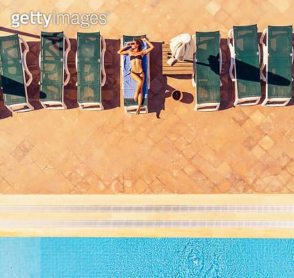 Beautiful Woman Sunbathing, Drone View - gettyimageskorea
