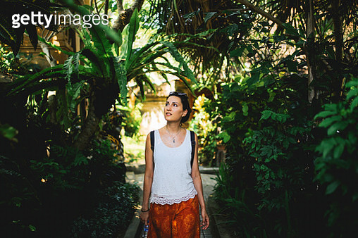 Young tourist woman walking through the tropical forest in Bali, Indonesia - gettyimageskorea