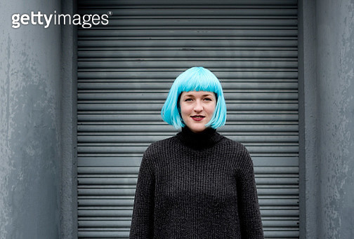 Young woman wearing blue wig - gettyimageskorea