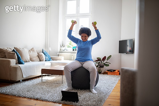 Woman is doing online workout during covid-19 lockdown - gettyimageskorea