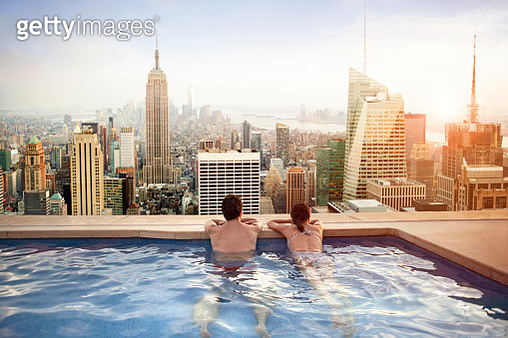 Couple relaxing on hotel rooftop - gettyimageskorea