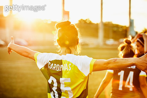 Rear view of female soccer player celebrating on field during soccer game - gettyimageskorea