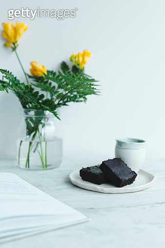 Brownies and flowers with book on marble - gettyimageskorea