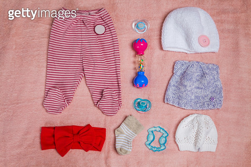 Newborn baby (girl) clothes on blue background. Knolling style. - gettyimageskorea