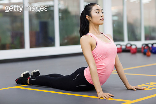 Young woman practicing yoga at gym - gettyimageskorea