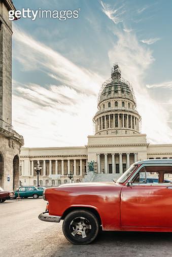red american vintage car in front of Capitol in Havanna - gettyimageskorea