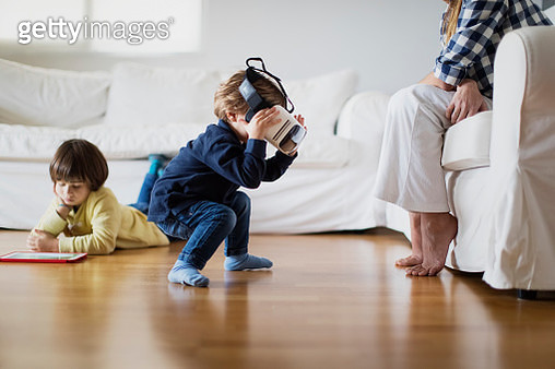 Young boy using a virtual reality headset at home - gettyimageskorea