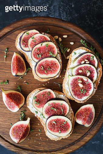 Appetizer bruschetta or toast with fresh cheese, figs and honey - gettyimageskorea