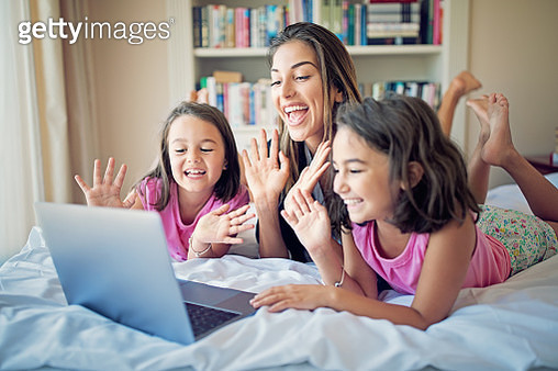 Mother and her daughters are making video call - gettyimageskorea