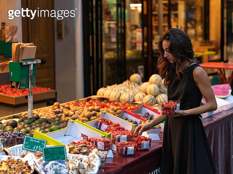 Stylish young women buying strawberries in Paris France - gettyimageskorea