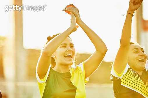Female soccer players cheering during game - gettyimageskorea