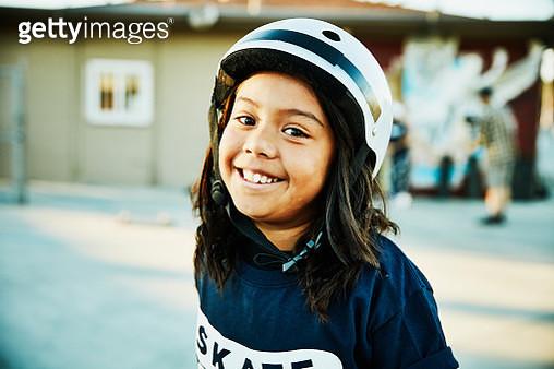 Portrait of young female skateboarder at summer skate camp - gettyimageskorea