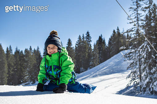 Happy little boy playing on winter snow day. - gettyimageskorea