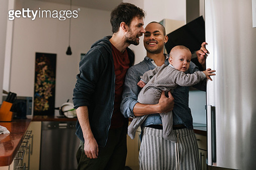 Smiling Gay Men with Baby - gettyimageskorea