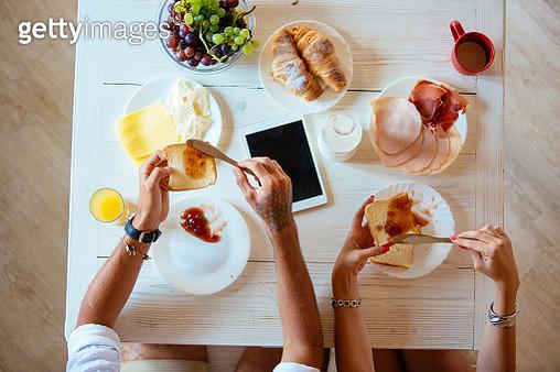 Above view of couple having breakfast - gettyimageskorea
