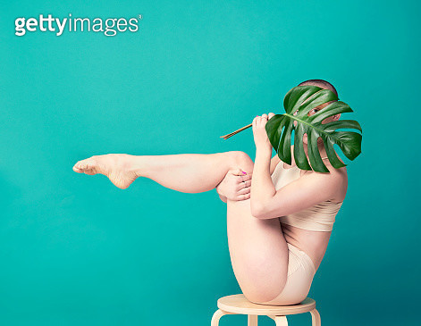 woman holding leaf in yoga pose - gettyimageskorea