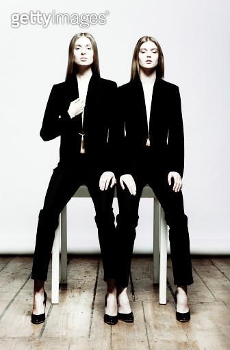 Two young women wearing black fashion wear - gettyimageskorea