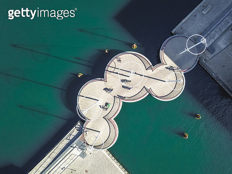 Drone top view of famous Cirkelbroen (The Circle Bridge) spans Christianshavns Canal on the Inderhavn or Inner Harbor of Copenhagen, capital city of Denmark. Taken by drone from aerial above. - gettyimageskorea