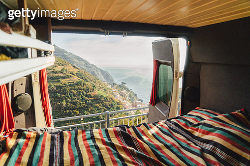 Camper van  bed with  view on Cinque Terre seaside  in Italy - gettyimageskorea