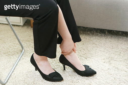 Businesswoman with ankle pain - gettyimageskorea