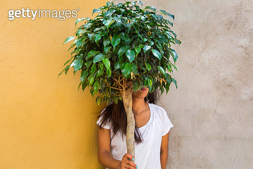 A young woman trying to hide - gettyimageskorea