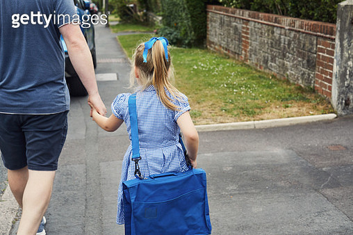 Father and child walking to school - gettyimageskorea