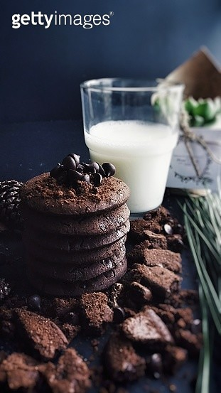 Cookies And Glass Of Milk On Table - gettyimageskorea