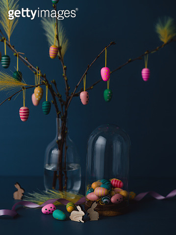 Easter still life with twigs and egg decorations with cruelty free artificial feathers on dark blue - gettyimageskorea