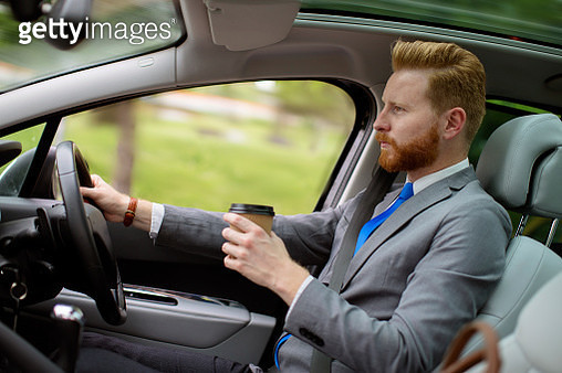 Man drinking coffee to go while driving - gettyimageskorea